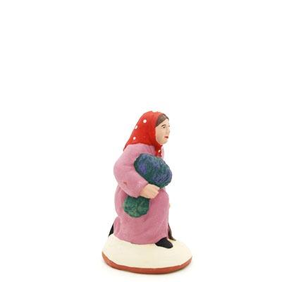 santon de provence peint à la main ramasseuse lavande accroupi profil