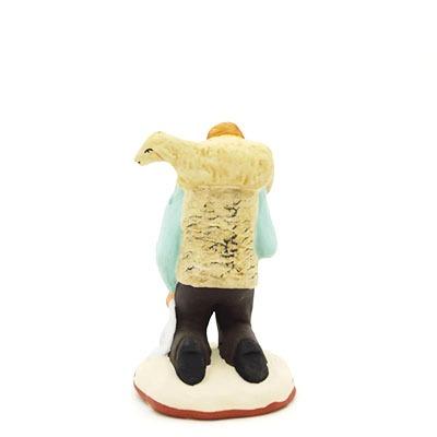 Le berger à genoux dos