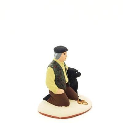 santon de provence peint à la main truffier avec son chien profil