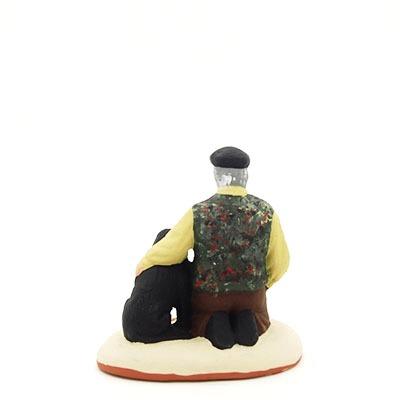 santon de provence peint à la main truffier avec son chien dos